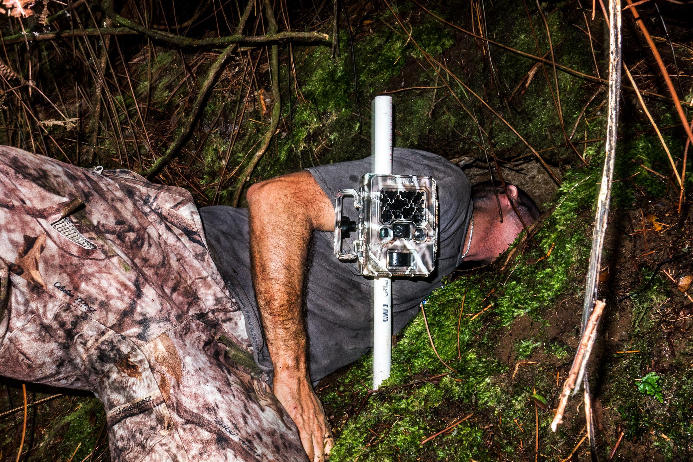 Raine checks a Hawaiian Petrel burrow in the Pōhākea area of the reserve. Tom Fowlks