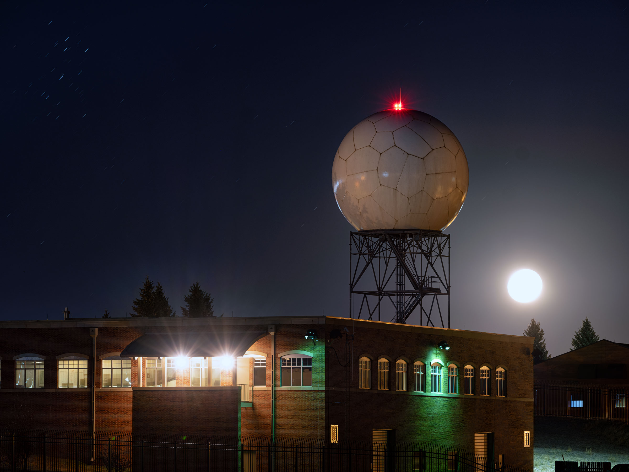 Waves scattered from this NOAA Doppler radar tower in Wyoming help detect nighttime migratory birds—data that Horton uses to create BirdCast forecasts. Keith Ladzinski
