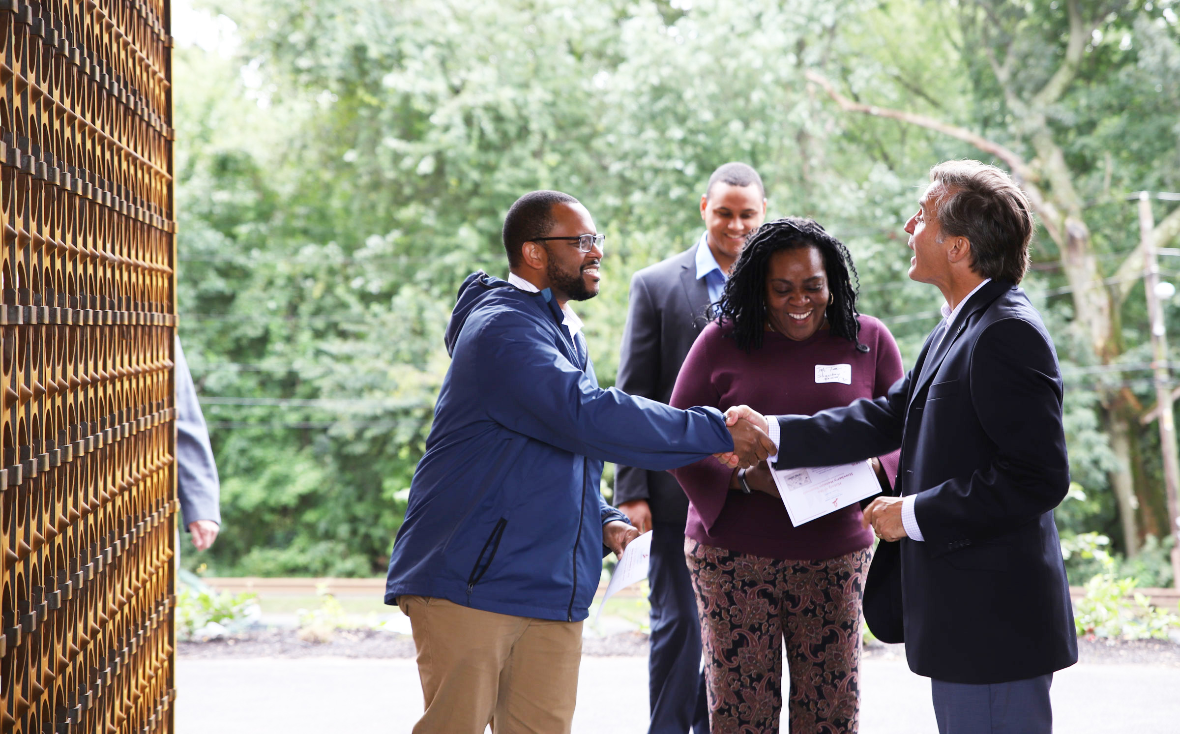 Audubon Pennsylvania executive director Greg Goldman (right) meets members of the Strawberry Mansion community at the opening of the Discovery Center. Dominic Arenas/Audubon