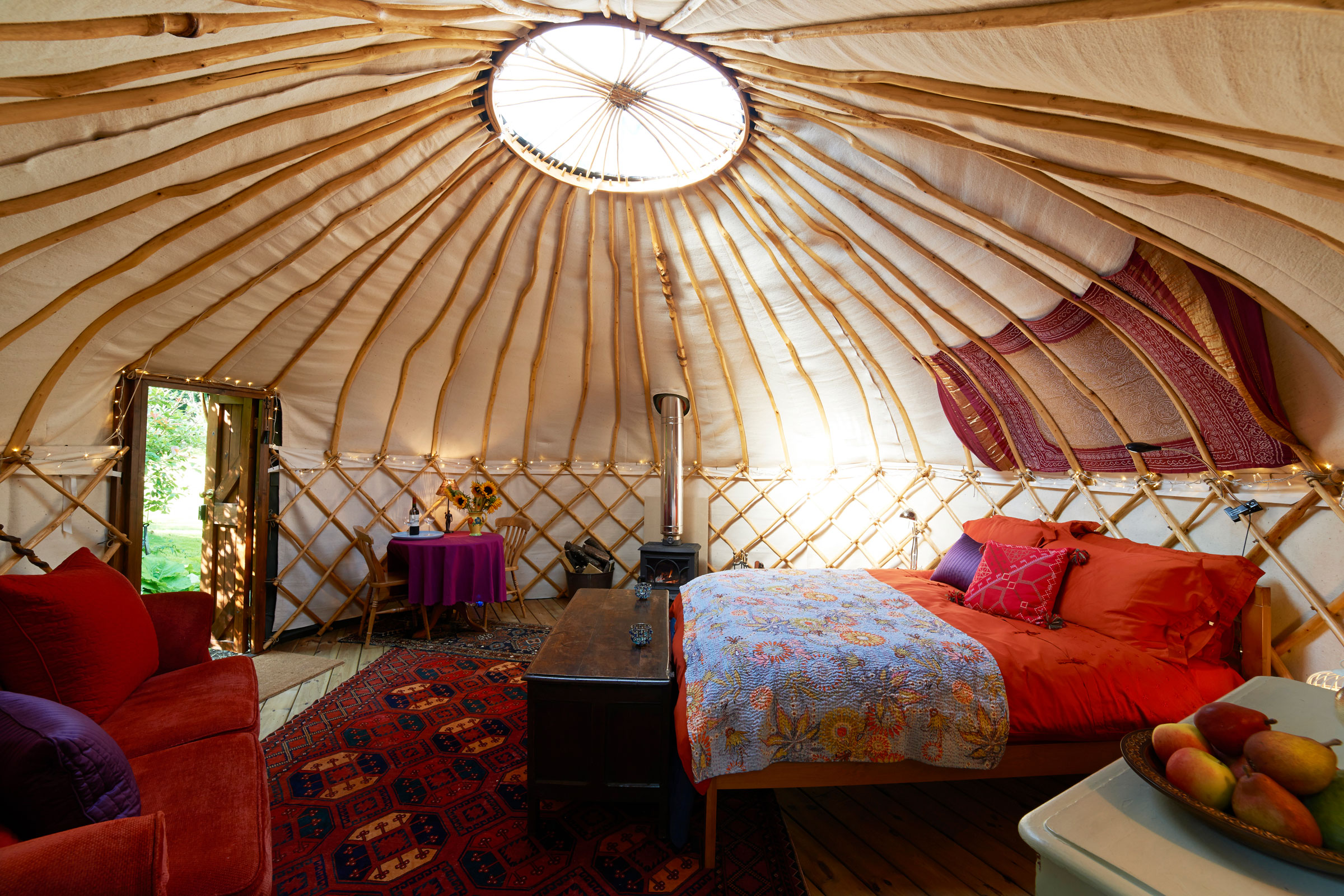 Ooh la la—glamping lets you camp in comfort and wake up with the birds. istock