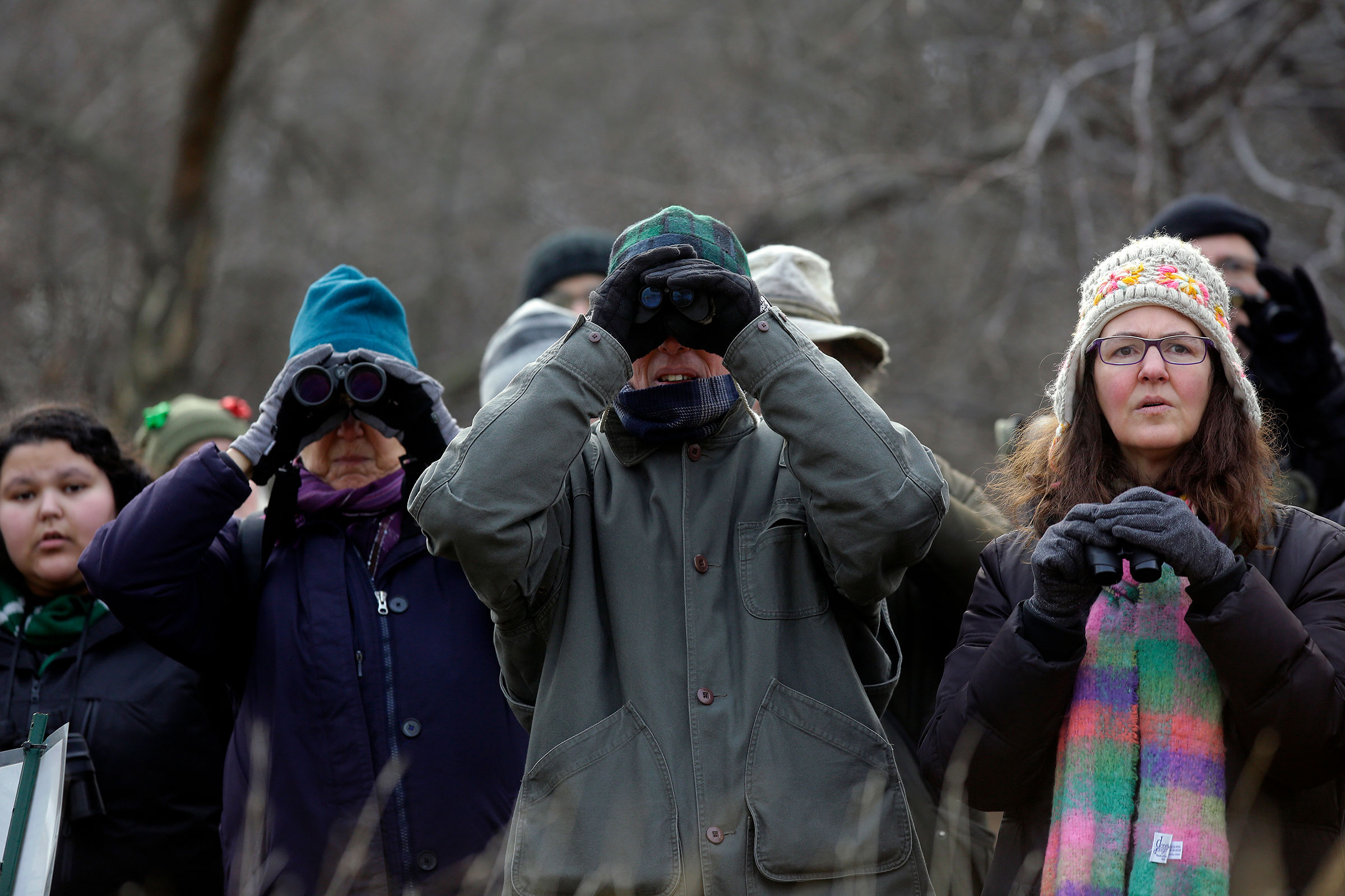 Participants look through their binoculars along Lake Michigan during the annual Christmas Bird Count. A Western Grebe and Piping Plover spotted this year were firsts for this circle. Joshua Lott
