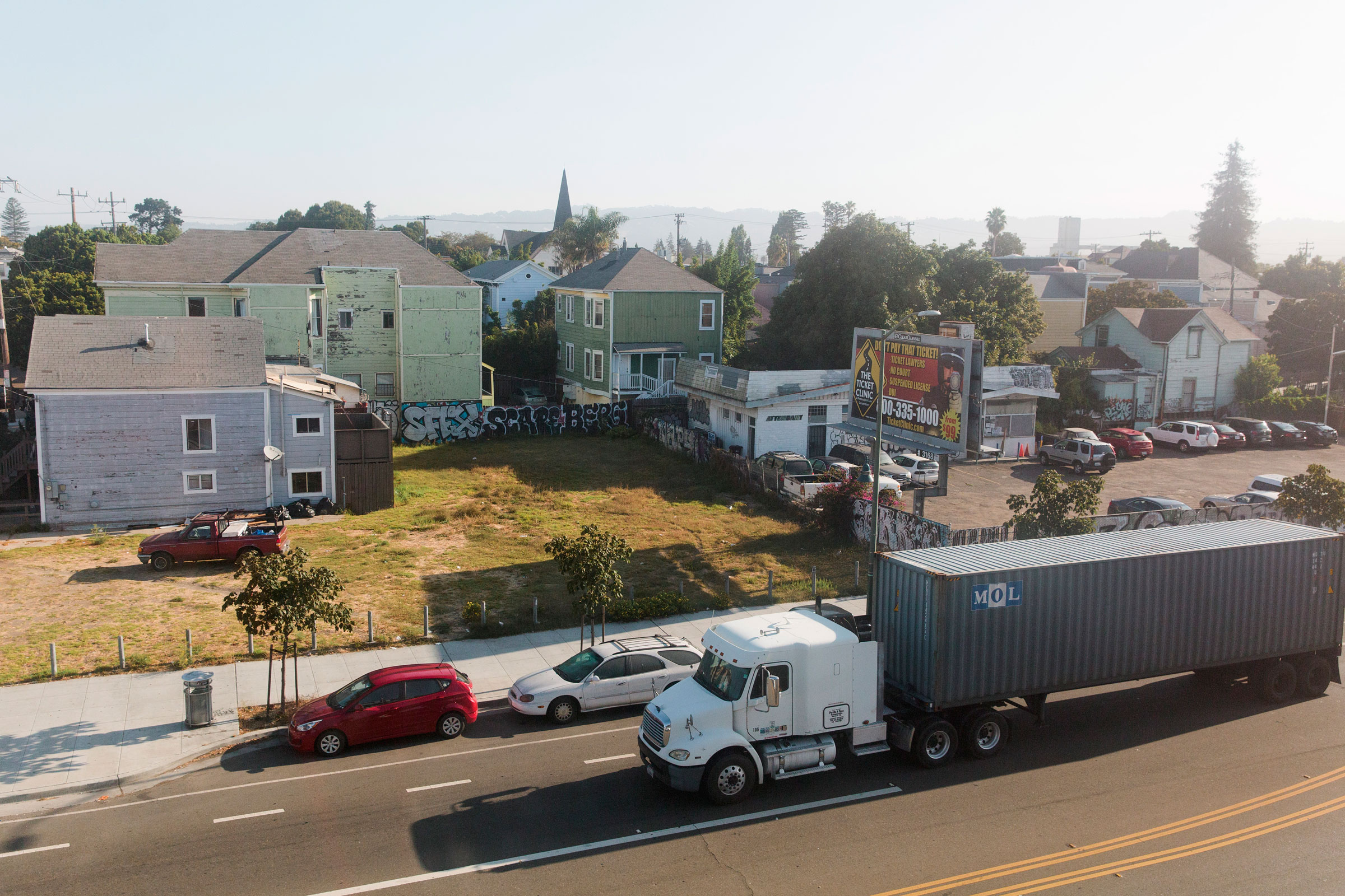 On their way back and forth from the Port of Oakland, large trucks pass by residential neighborhoods. Alison Yin