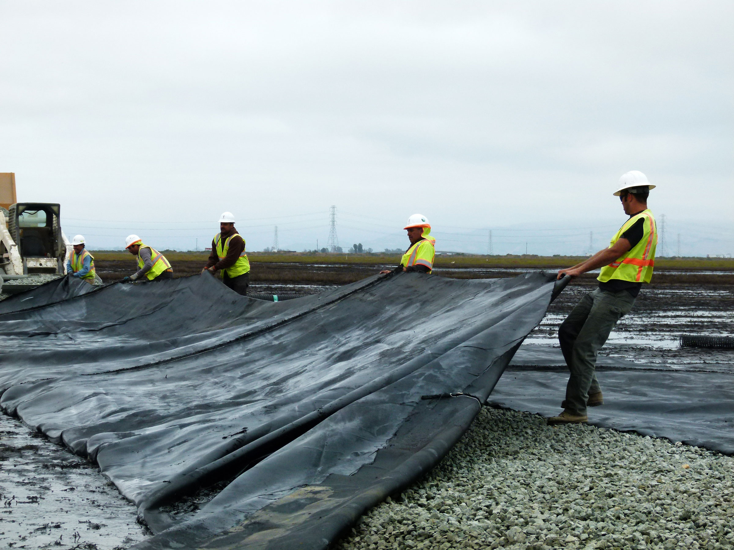 Tarp is laid over the drain rock to create an access road to the site. Andrea Jones/Audubon