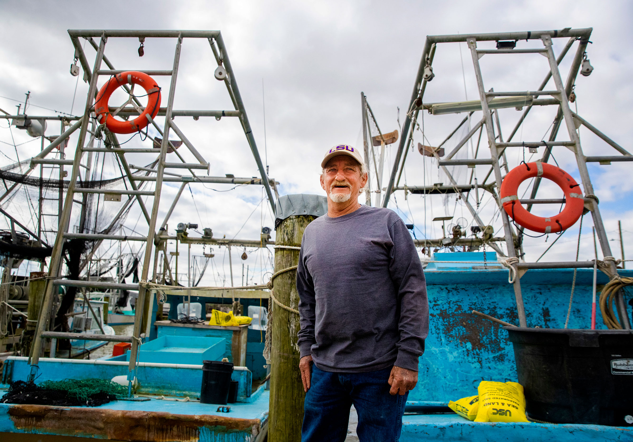 Third-generation shrimper Acy Cooper worries the project will put him out of business.