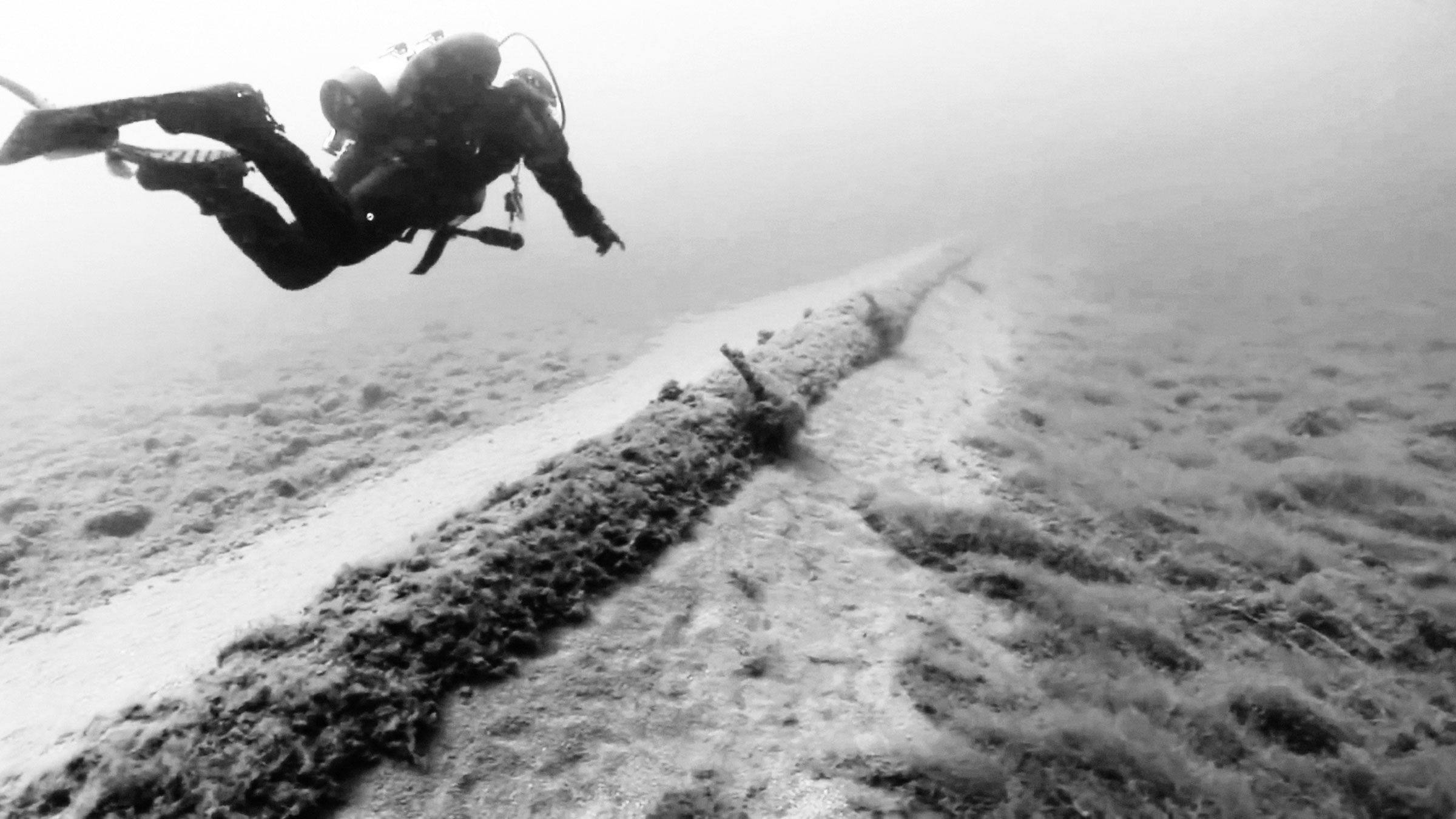 A diver with the National Wildlife Federation examines Line 5, Enbridge's oil and gas pipeline running along the bottomlands of the Straits of Mackinac. Screenshot: National Wildlife Federation