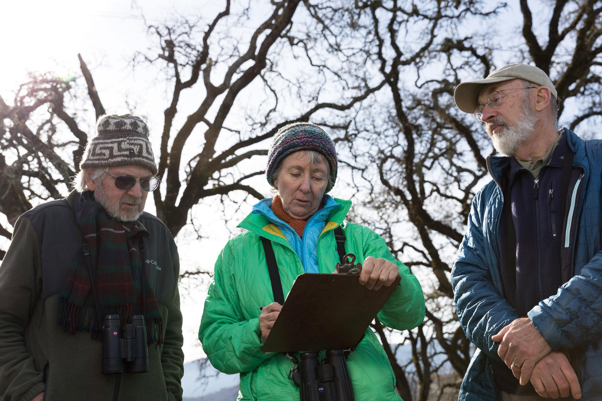 Rodney Jackson, Ann Howland, and David Leland tally birds on the border of Stone Edge Farm and Silver Cloud Vineyard. Ryan Young