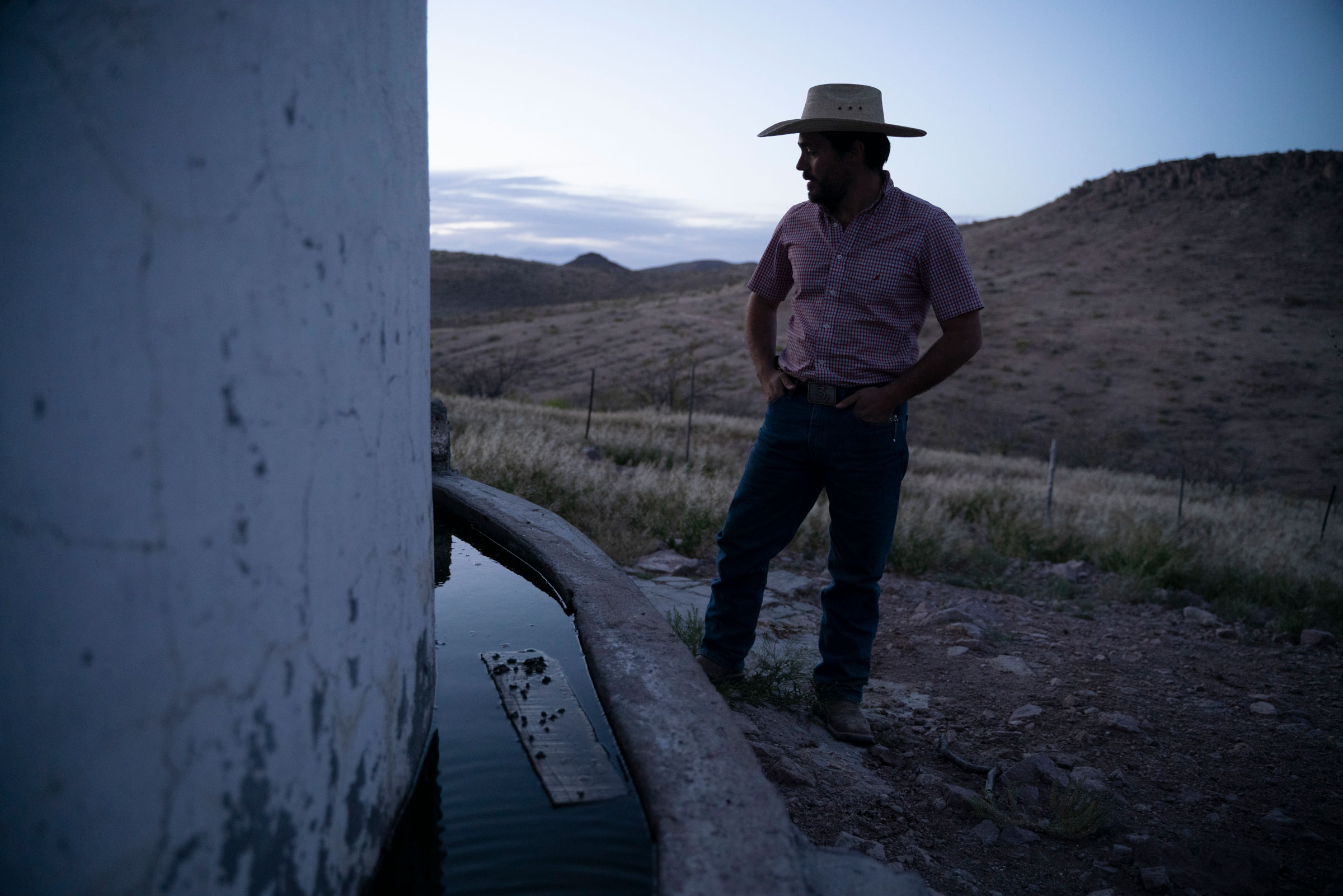 Enrique Perez Carrillo, 31, checks the water level of a water tank on his ranch. Paul Ratje