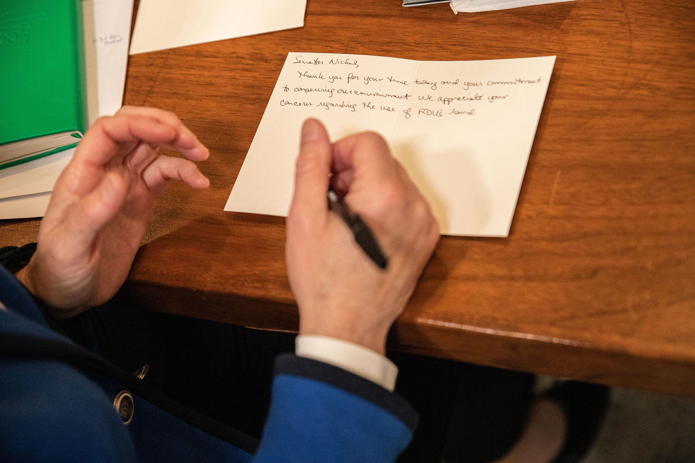 Mary Abrams, Audubon ambassador and chair of Wake Audubon's advocacy committee, pens a thank you card to her local senator after their meeting and tour of the North Carolina capitol building. Dominic Arenas/Audubon