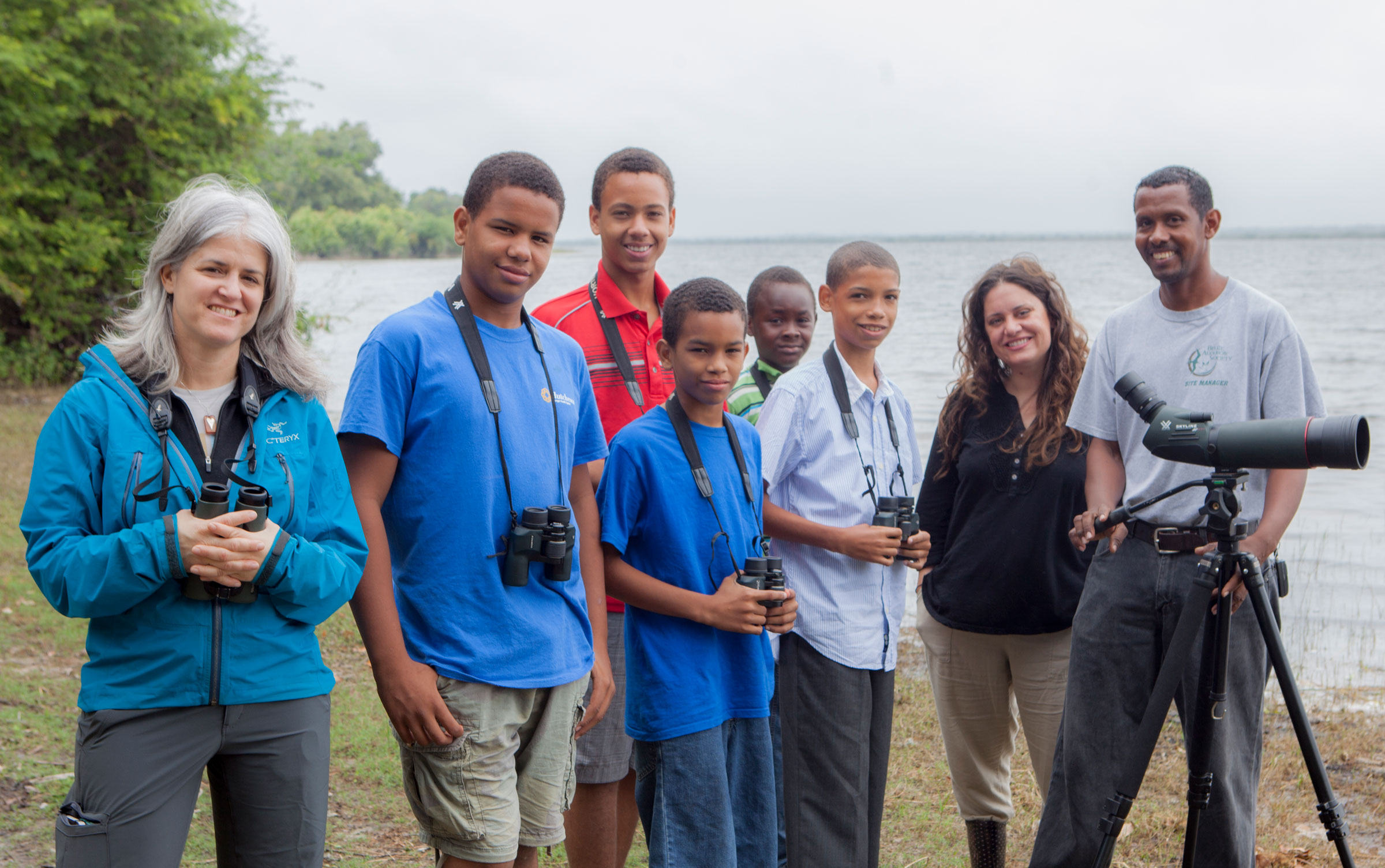 From left: Brand, Dayna Reggero of the Climate Listening Project, and Derick Hendy of Belize Audubon Society with the Crooked Tree Wildlife Sanctuary Junior Bird Club. Andrea Desky/Climate Listening Project