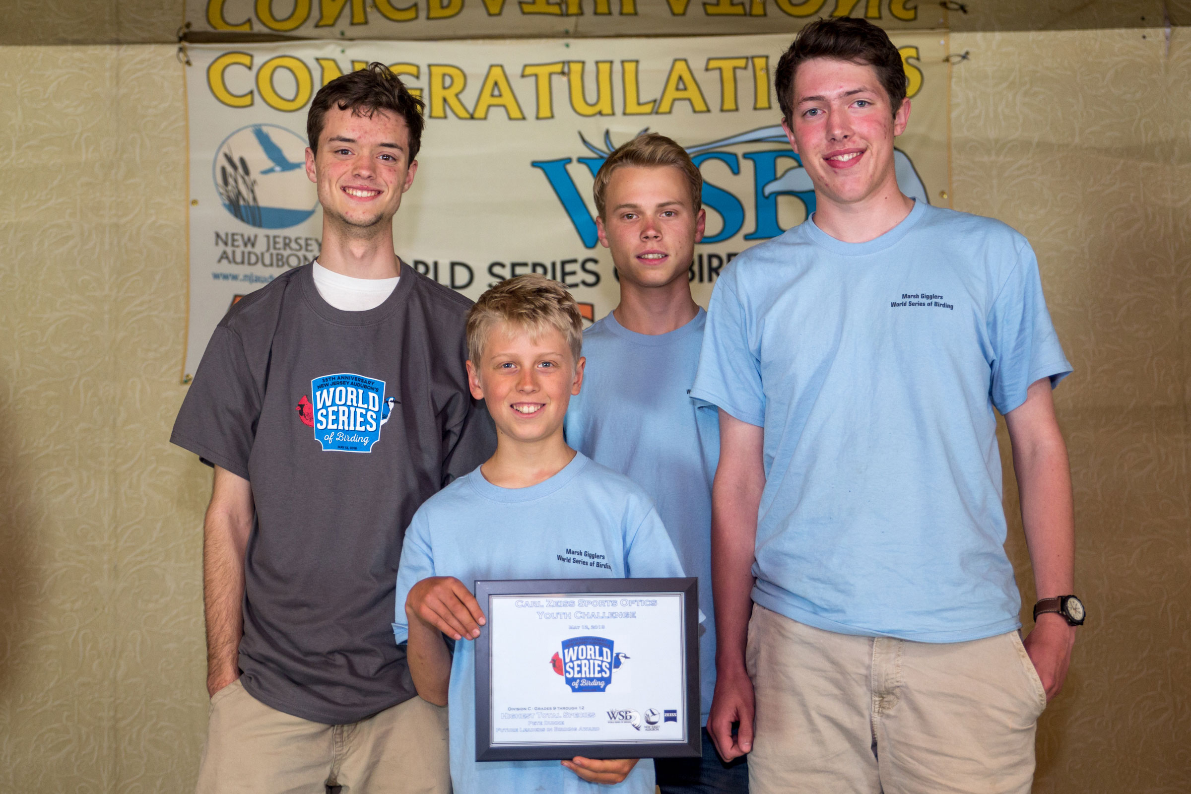 Joshua Heiser, Jonathan Irons, Daniel Irons, and Patrick Newcombe hold up their winning plaque at the awards brunch at the Cape May Inn. Camilla Cerea/Audubon